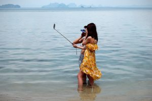 Chinese tourists on beach, WeChat marketing services